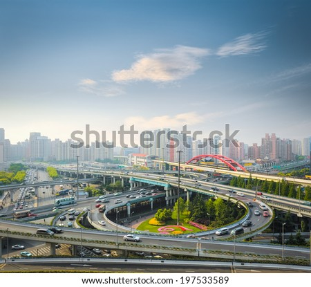 city interchange in rush hour with the early morning sky ,shanghai ,China  - stock photo