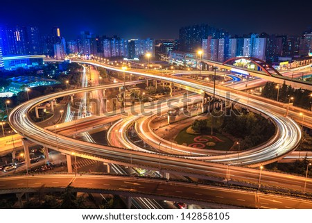 city interchange overpass at night in shanghai - stock photo