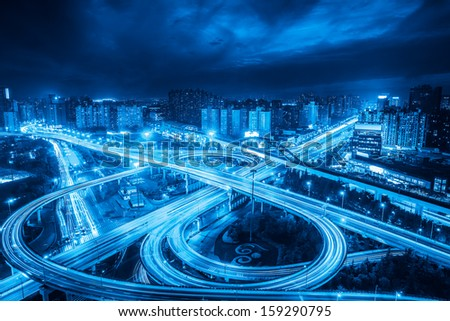 city interchange overpass at night in shanghai  ,blue tone - stock photo