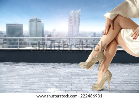 city landscape and legs of woman  - stock photo