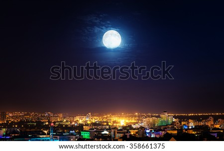 City landscape at nigh with moon. Elements of this image furnished by NASA. - stock photo