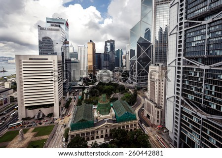 City landscape with business buildings by day in Hong Kong - stock photo