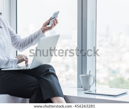 City lifestyle woman hands working on computer typing laptop keyboard using IOT IT SEO 4G 5G wifi cyber internet online digital media interactive technology pc device in urban office space environment - stock photo