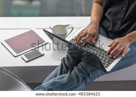 City lifestyle woman hands working on computer typing laptop keyboard using wifi cyber internet online digital media interactive technology pc device in office space environment