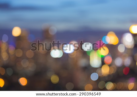 City light blur bokeh, abstract defocused background during twilight - stock photo