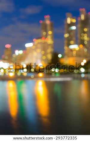 City light blur bokeh, defocused background with water reflection - stock photo