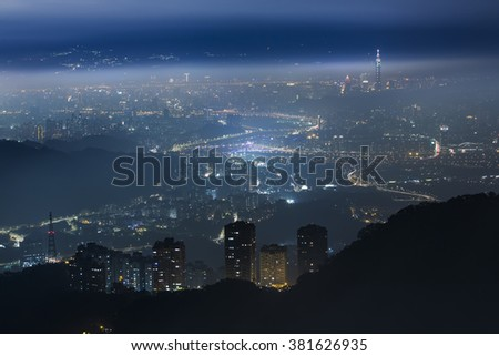 City lights in the foggy night, mysterious. - stock photo