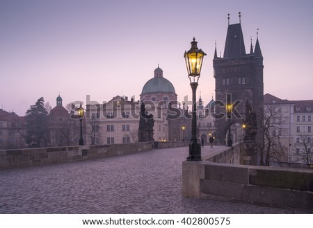 City lights on the bridge in the morning in Prague in Czech republic