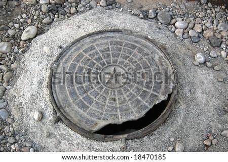 City manhole broken cover USSR - stock photo
