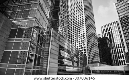 City modern architecture in perspective, tall buildings in black and white - stock photo