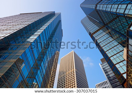 City modern architecture in perspective, tall buildings with sky - stock photo