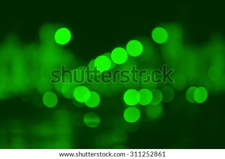 City night light on green abstrack blur bokeh, defocused background - stock photo