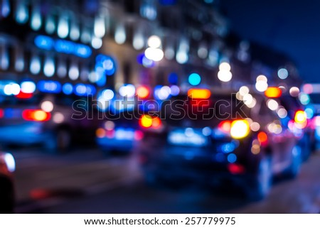 City night lights, cars are on the road in traffic jam. In blue tones - stock photo