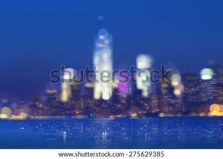 city night lights night view of lower manhattan, new york, with a layered, soft double exposure effect - stock photo