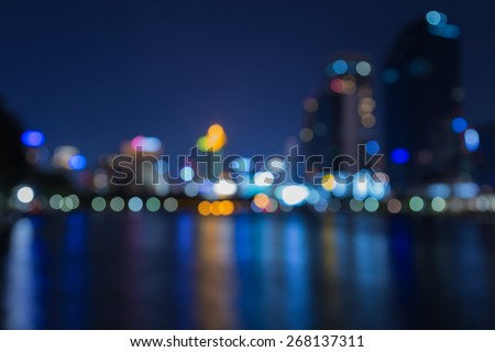 City night lights out of focus with water reflection, twilight - stock photo