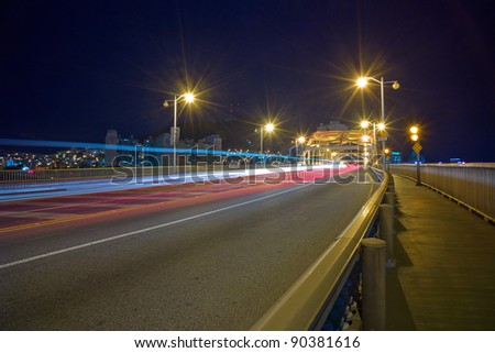 City night scene with car lights in Busan, South korea - stock photo