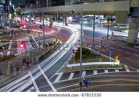 City night scene with car motion lights in Tokyo, Japan - stock photo