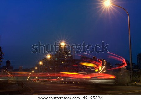 City night scenic of colorful car motion blurred lines and light. - stock photo