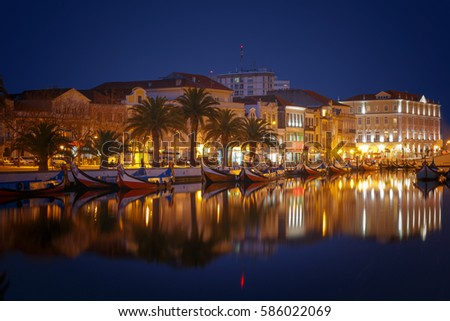 City of Aveiro canals with moliceiro boats by night