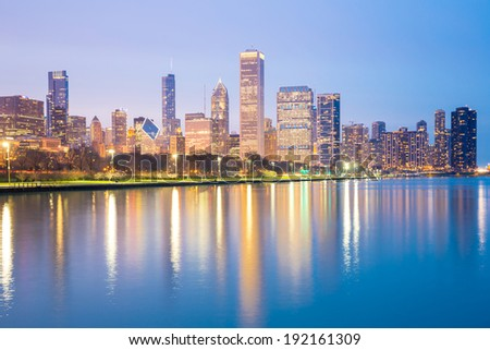 City of Chicago downtown and Lake Michigan at dusk. - stock photo