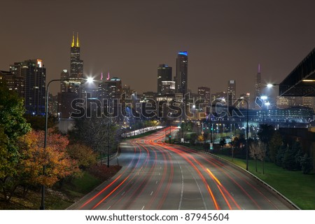 City of Chicago. Image of modern dynamic city of Chicago at night. - stock photo