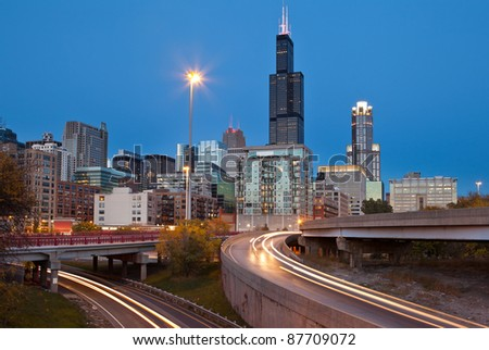 City of Chicago. Image of modern dynamic city of Chicago at twilight. - stock photo