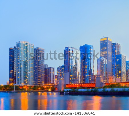 City of Chicago USA,   colorful sunset panorama skyline of downtown with illuminated business buildings with reflections - stock photo