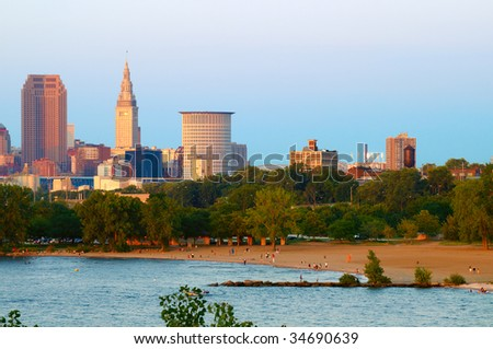 City of Cleveland, Ohio, and beach at Edgewater State Park at sunset - stock photo