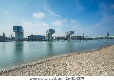 City of cologne in german at the rhine crane houses buildings - stock photo
