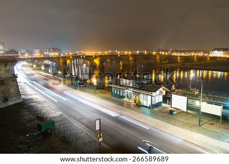 City Of Dresden; Germany With Albert Bridge Illuminated With Golden Light At Night - stock photo