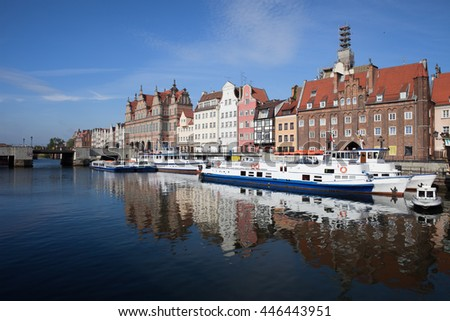 City of Gdansk by night in Poland, Old Town skyline and cityscape, view from Motlawa River - stock photo