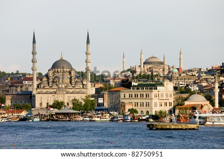 City of Istanbul, view from the Golden Horn on the left side New Mosque (Yeni Valide Camii) on the far right Hagia Sophia (Ayasofya) - stock photo