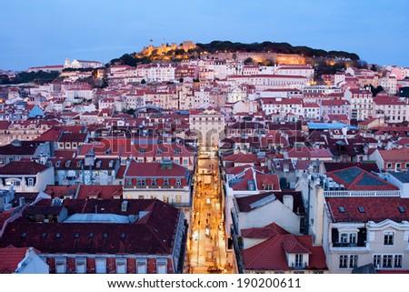 City of Lisbon at dusk in Portugal, illuminated Rua de Santa Justa pedestrian street in the middle. - stock photo