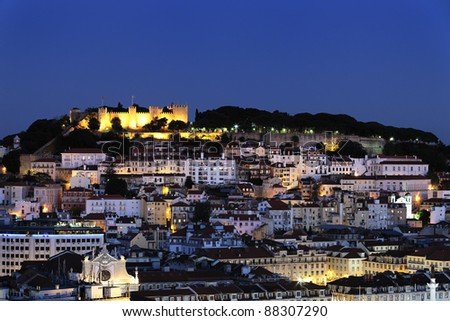City of Lisbon illuminated at dusk, Portugal - stock photo