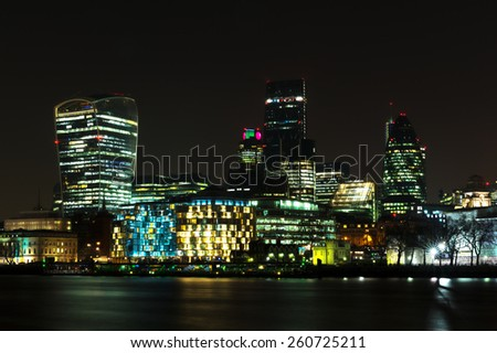 City of London at Night, one of the leading centers of global finance.This view includes Tower 42 Gherkin,Willis Building, Stock Exchange Tower and Lloyd`s of London and Walkie Talkie. - stock photo
