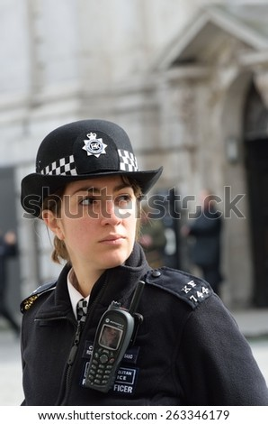 CITY OF LONDON ENGLAND 13 March 2015: Policewoman on duty - stock photo
