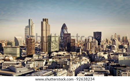 City of London one of the leading centers of global finance and Canary Wharf at the background. - stock photo