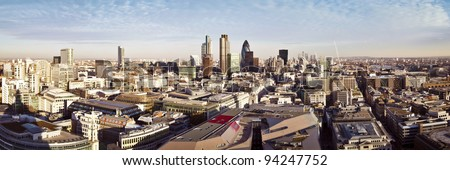 City of London one of the leading centres of global finance. This panoramic view includes Tower 42, Gherkin,Willis Building, Stock Exchange Tower, Lloyd`s of London, the Tower Bridge and Canary Wharf. - stock photo