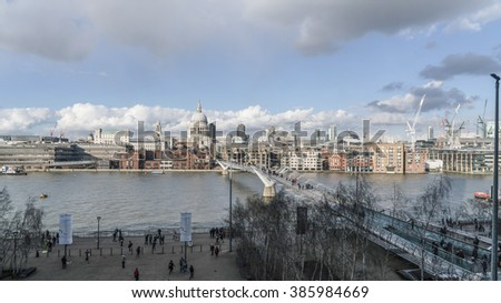 City of London skyline with Millennium Bridge and River Thames LONDON, ENGLAND - FEBRUARY 22, 2016