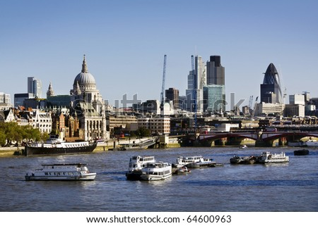 City of London view from Waterloo Bridge. This view includes: St. Paul`s Cathedral, The Gherkin, Tower 42, and Blackfriars Bridge. - stock photo