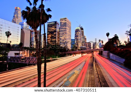 City of Los Angeles Downtown at Sunset With Light Trails - stock photo