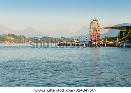 City of Lucerne. Amusement park with a Ferris wheel. Shore of the lake, autumn. Filter softlight - stock photo