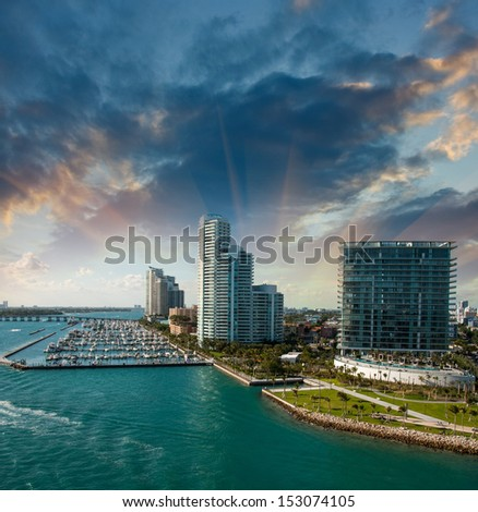 City of Miami Florida, colorful night panorama of downtown business and residential buildings. - stock photo
