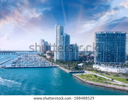 City of Miami Florida, colorful night panorama of downtown business and residential buildings. Vintage filter - stock photo