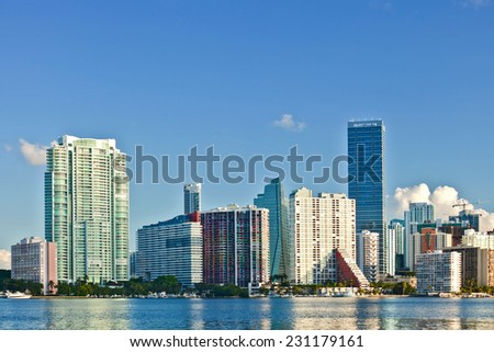 City of Miami Florida, summer panorama of downtown buildings on a beautiful day with blue sky  - stock photo