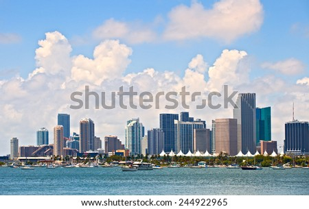 City of Miami Florida, summer panorama of downtown buildings on a beautiful day with blue sky and Biscayne Bay - stock photo