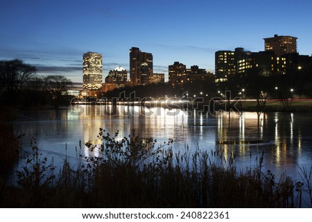 City of Milwaukee skyline at dusk. Reflections of the cities lights in water. - stock photo