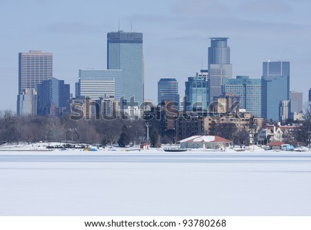 City of Minneapolis as viewed from a frozen lake. - stock photo