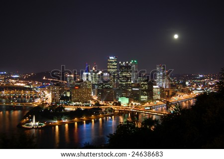 City of Pittsburgh at Night with Full Moon - stock photo