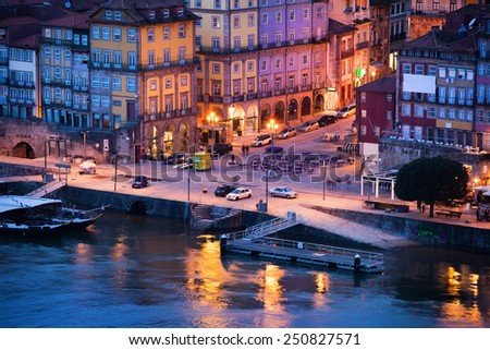 City of Porto in Portugal at dusk, historic houses by the Douro river in the Old Town. - stock photo